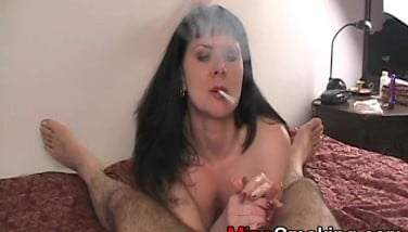 Housewife Gives Bj While Smoking Cigarette